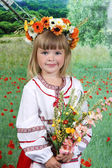 Cute girl in national dress and a wreath — Stock Photo