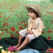 Stock Photo: Boy in rural attire at Flower Field