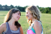 Two beautiful girls talk — Stock Photo