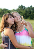 Two girls review and discuss — Stock Photo