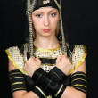 Royalty-Free Stock Photo: Beautiful girl in the Egyptian costume on a black background