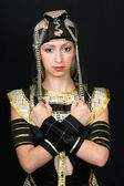 Beautiful girl in the Egyptian costume on a black background — Stock Photo