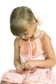 Cute little girl paints the nails — Stock Photo