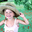 Laughing girl in a straw hat — Stock Photo