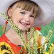 Stock Photo: Beautiful girl in a hat with wildflowers