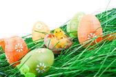 Easter eggs, chicken in grass — Stock Photo