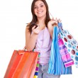 Girl holding shopping bags and cell phon — Stock Photo