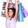 Young woman  holding colorful bags — Stock Photo