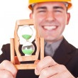Close-up of hourglass and engineer — Stock Photo