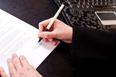 Close-up of signing papers — Stock Photo