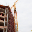 Stock Photo: Building with construction crane