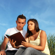 Lovely couple learning — Stock Photo