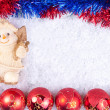 Christmas bals and snowman on snow - Foto Stock
