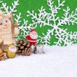 Santa Claus figures and snowman — Stock Photo