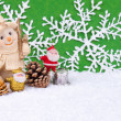 Santa Claus figures and snowman — Stock Photo #2831333