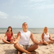 Three meditating — Stock Photo #2831867