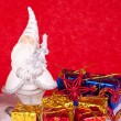 Santa ceramic figure on red background — 图库照片