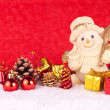 Stock Photo: Cute snowman figure on red background