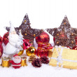 Toy santa with xmas ornaments — Stock fotografie