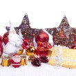 Toy santa with xmas ornaments — Stock Photo
