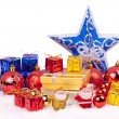 Red, blue, gold xmas ornaments — Stock Photo