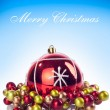 Merry chrsitmas text and red xmas ball — Stockfoto