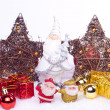Ceramic santa figure with xmas ornaments — Stock Photo