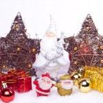 Ceramic santa figure with xmas ornaments — Stock Photo