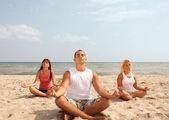Three meditating — Stock Photo