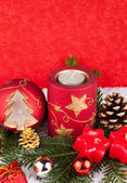Xmas candles on red background — Stock Photo