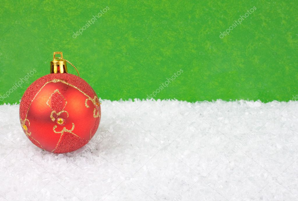 Red Christmas ball in snow - chrsitmas background — Stock Photo #2830792