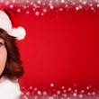 Cute girl in santa claus cloth — Stock Photo