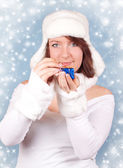 Xmas girl opening a gift with snowflakes — Stock Photo