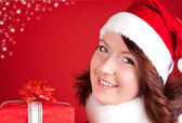 Beautiful girl in santa clothes — Stock Photo