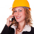 Businesswoman with helmet and phone — Stock Photo