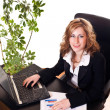 Businesswoman sitting in her office — Stock Photo