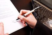 Signing a business document — Stock Photo