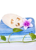 Loofah, candle and towel — Stock Photo