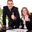 Business colleagues with thumbs up — Stock Photo
