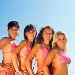 Group of happy girls in bikinis — Stock Photo