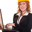 Businesswoman with helmet and laptop — Photo