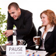 Stock Photo: Colleagues on coffee-break discussing