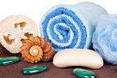 Soap, towel, loofah on mat — Stock Photo