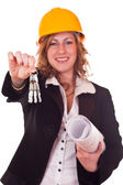 Architect woman giving keys — Stock Photo
