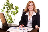 Blond businesswoman in office working — Stock Photo