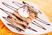 Pancake with chocolate syrup — Stock Photo