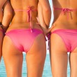 Girls back on beach — Stock Photo
