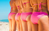 Young girls bottom in pink bikini — Stock Photo