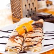 Sweet pancakes with orange peel — Stock Photo