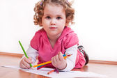 Cute girl is drawing — Stock Photo